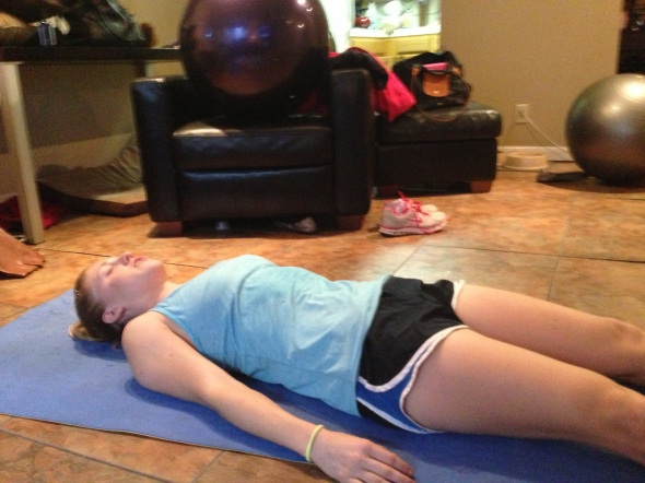 Maddie is either in Savasana or passed out.