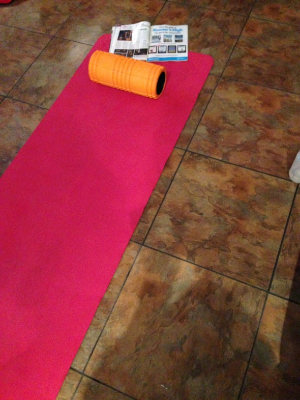 My mat, Runner's World and foam roller torture device of choice, the Trigger Point.
